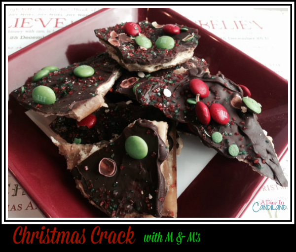 Christmas-Crack-with-M-Ms-on-a-Red-Plate-so-delicious-and-addicting