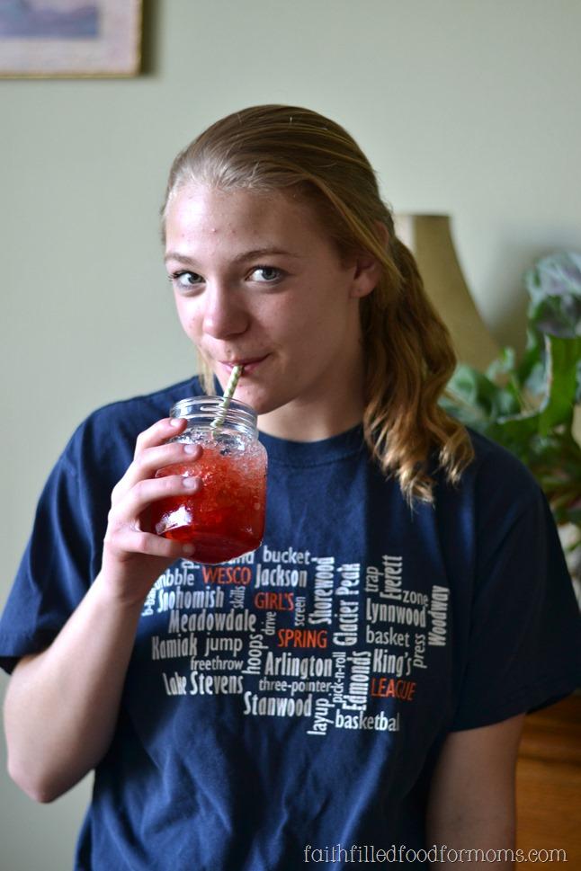 girl drinking slushy