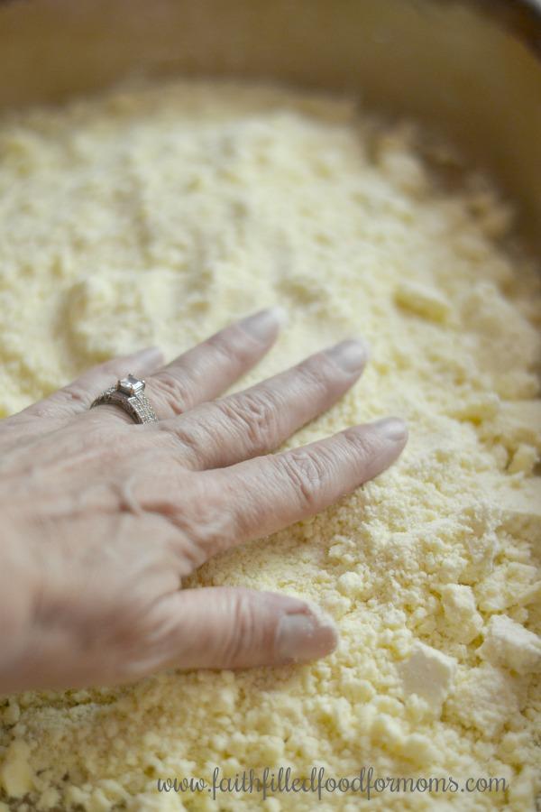 patting down cake mix