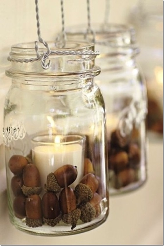 mason jars with acorns and candle